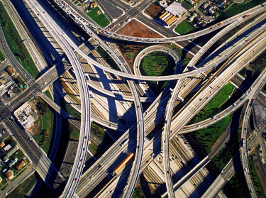 NP00866258 Aerial view of freeway interchange in Los Angeles looking like cemented spagetti
