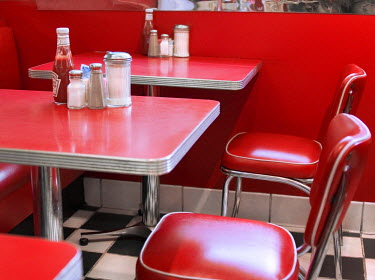 NP01112914 Empty chairs and tables in a cafe, New York State, USA