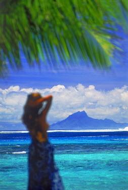 NP01114122 Polynesian on Huahine Island in French Polynesia with Raiatea in distance