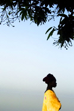 NP01283582 Silhouette Of A Woman Standing Under A Tree, Senegal
