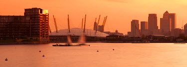 UK10235 UK, England, London, Royal Victoria Dock, Canary Wharf skyline and O2 Arena (Millennium Dome)