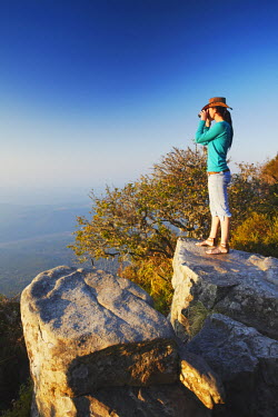 SAF6012AW Woman at God's Window, Drakensberg Escarpment, Mpumalanga, South Africa (MR)