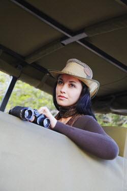 SAF6047AW Woman sitting in safari truck, Kruger National Park, Mpumalanga, South Africa (MR)