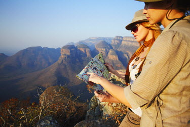 SAF6048AW Women looking at map at Three Rondavels, Blyde River Canyon, Drakensberg Escarpment, Mpumalanga, South Africa (MR)