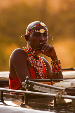 Kenya, Masai Mara National Reserve. A safari guide spotting for tourists whilst out on safari.