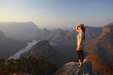 SAF6130AW Woman at Blyde River Canyon, Drakensberg Escarpment, Mpumalanga, South Africa (MR)