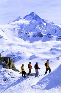 AR9573000018 Skiers enjoy view in Switzerland.