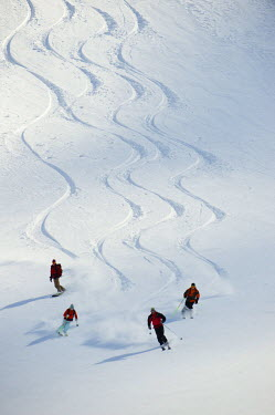 AR3325100042 A group of backcountry skiers follow their guide down a slope in the Selkirk Mountains, Canada.
