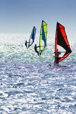 AR3934500048 Windsurfers enjoy warm breezes in Key Biscayne near Miami, Florida.
