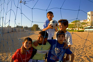 Tripoli, Libya; Children posing for a photograph after a football match in the outskirts of the city