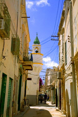 LIB1450 Tripoli, Libya; One of the typical streets in the old Medina of Tripoli with a minaret from a Mosque prominent in the background