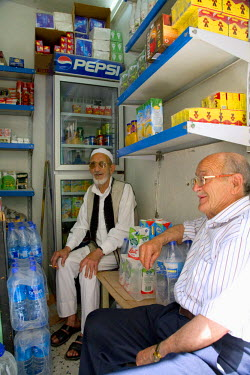 LIB1451 Tripoli, Libya; A grocery shop seller who remembers vividly the Italian rule speaking to a client in his small outlet in the old Medina