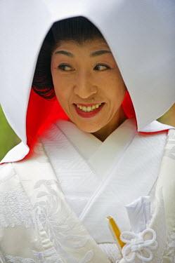 JAP0335 Asia, Japan. Kyoto, Kamigamo Jinja shrine, woman in bridal gown
