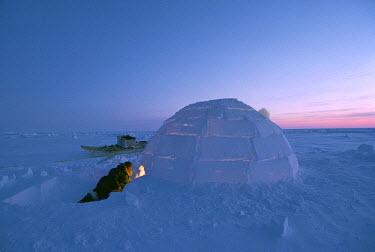 AR1891411917 An igloo at sunset, Nunavut, Canada.