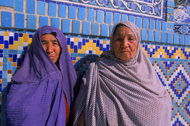 AR9071800044 Uzbek women peek out from their veils in front of the tiled wall of the Blue Mosque, Mazar-i-Sharif, Balkh Province, Afghanistan