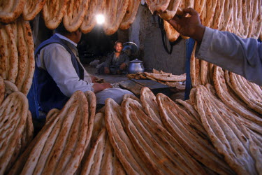 AR9071900031 Typical Afghan nan or unleavened bread hangs from the outside of a traditional bakery in the old market area of Kabul. Afghanistan
