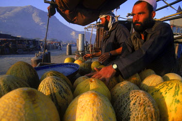 AR9071900038 Men sell melons, an Afghan specialty, along the partly ruined streets of Kabul, Afghanistan.