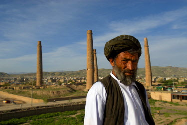 AR9677500004 A guard at Queen Gawhar Shad's mausoleum, stands in front of four tall minarets, once part of a madrassa that was built in the 15th century by the last of the Timurid rulers, in Herat, Herat Province,...