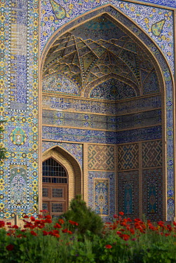 AR9677600095 Floral and geometric patterns of  restored Timurid tile mosaics decorate an archway at the main entrance to the Friday Mosque or Masjid-i Jami, which dates to 1200 AD and is the largest mosque in Hera...