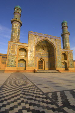 AR9677600098 The tiled walls and minarets of the Friday Mosque of Masjid-i Jami, the largest mosque in Herat, glow in the morning sun in the main mosque courtyard, Afghanistan.