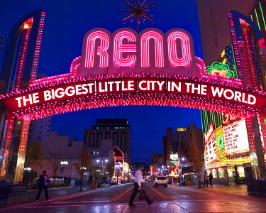 AR9744500051 Glittering icon archway advertising Reno - The Biggest Little City In the World at night, leading into the casino quarter in Reno, Nevada