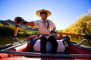 AR9749600020 A river guide rafting the Rio Grande River, Big Bend National Park, Texas