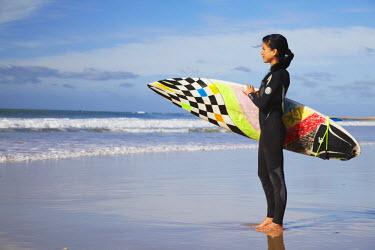 SAF6448AW Woman with surfboard on beach, Jeffrey's Bay, Eastern Cape, South Africa (MR)