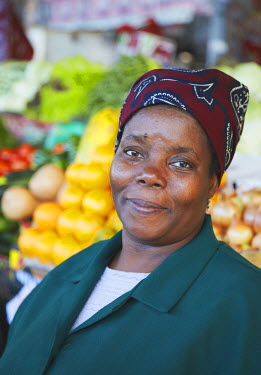 MOZ1525AW Fruit and vegetable vendor in municipal market, Maputo, Mozambique