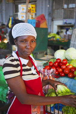 MOZ1521AW Fruit and vegetable vendor in municipal market, Maputo, Mozambique