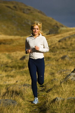 WAL7171 North Wales, Snowdonia.  Woman running on the flanks of Mount Snowdon. (MR)