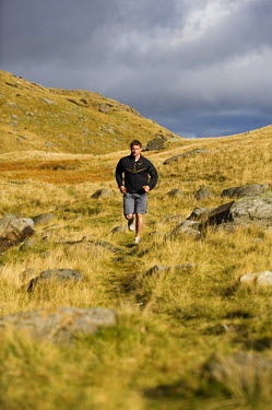 WAL7172 North Wales, Snowdonia.  Man running on the flanks of Mount Snowdon. (MR)