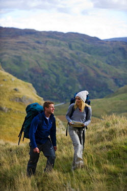 WAL7173 North Wales, Snowdonia.  Man and woman trekking on the flanks of Mount Snowdon. (MR)