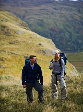 WAL7174 North Wales, Snowdonia.  Man and woman trekking on the flanks of Mount Snowdon. (MR)
