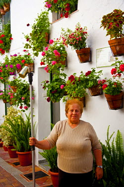 SPA3498 Woman and her garden in spring in Benalmadena, Andalusia, Spain