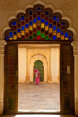 IN02174 View through doorway of woman sweeping, Meherangarh Fort, Jodhpur, Rajasthan, India