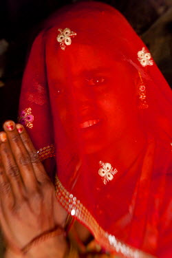 IN02169 Portrait of Indian (member of Bishnoi religous sect) woman behind veil, nr Jodhpur, Rajasthan, India