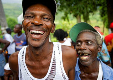 AR3194300011 Two pilgrims laugh during the festivities surrounding the Saut D'eau voodoo pilgrimage in Haiti.