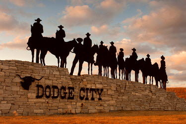 US50050 USA, Kansas, Dodge City, Silhouetted Ghost Riders Welcoming Sign, Metal Art Work