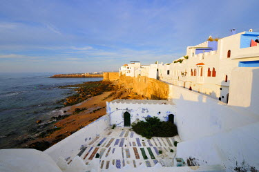 MOR1957AW Asilah's white houses and graveyard overlooking the Atlantic Ocean. Morocco