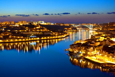 POR0593AW Oporto, capital of the Port wine, with the Douro river at sunset, Portugal