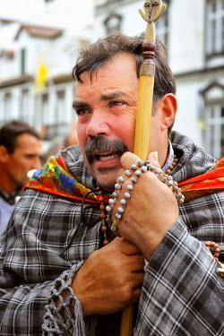 POR0609AW Portrait of a pilgrim (romeiro) during the Holy Christ festivities at Ponta Delgada. Sao Miguel, Azores islands, Portugal