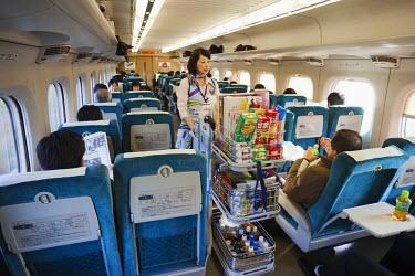TPX20873 Japan, Shinkansen Train Interior, Female Snack Vendor