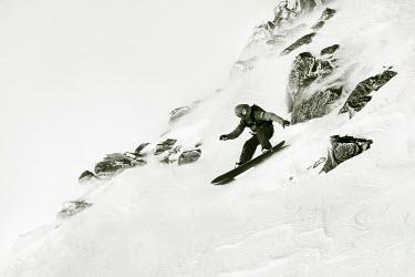 AR3108200006 Andorra la Vella, Andorra; One snowboarder during El Dorado Freeride competition, Andorra.