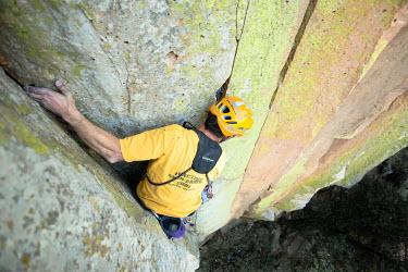 AR3151400006 Mexico, Queretaro: A man climbing and looking donw in Ca�on de Aculco, Queretaro, Mexico.