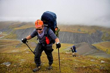 AR3158100002 Arctic National Wildlife Refuge, USA, Alaska: A backpacker hikes alon gthe Atigun River in Alaska's Arctic National Wildlife Refuge.