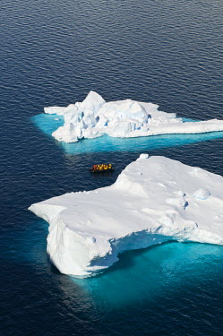 AR3272800006 Paradise Harbour, Antarctica, Danco Coast, Graham Land: Tourists on a motorized inflatable raft known as a zodiac, cruising amongst icebergs, Paradise Harbor, Danco Coast, Graham Land, Antarctica.