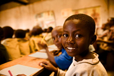 AR3321900017 Rugerero Genocide Survivor's Vil, Rwanda, Gisenyi: A young girl in the Rugerero classroom.