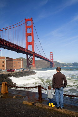AR3974000005 San Francisco, USA, California: A man and his son gaze at the Golden Gate Bridge near Fort Point in San Francisco.