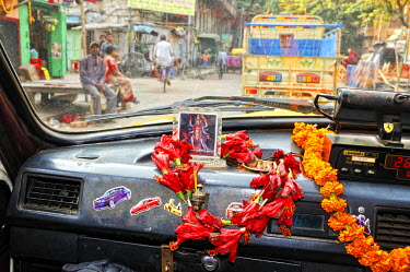 IND6262AW Taxi in the streets of Kolkata. India