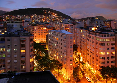 BRA0466 Bird's eye view on Ipanema at dusk with Favela in the background on the hill. Brazil